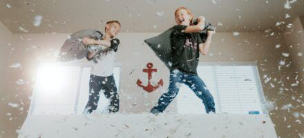 Two kids having a pillow fight. How To Talk To Your Kids About Porn